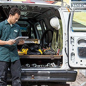electrician behind van representing commercial liability